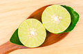 Slice Of Lemon With Green Leaf In Wooden Spoon. Royalty Free Stock Image - 85333886