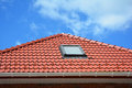 Skylight On Red Ceramic Tiles House Roof With Rain Gutter. Skylights, Roof Windows And Sun Tunnels.  Attic Skylight Solution Royalty Free Stock Photography - 85334687