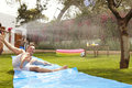 Family Having Fun On Water Slide In Garden Royalty Free Stock Photography - 85336897
