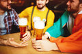 Men Get Together In Craft Beer Pub Royalty Free Stock Image - 85346916