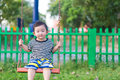 Young Asian Boy Play A Iron Swinging At The Playground Under The Stock Photo - 85348450