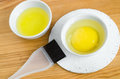 Raw Egg And Olive Oil In A Small Ceramic Bowls For Preparing Homemade Face And Hair Masks. Ingredients For Diy Cosmetics. Stock Photos - 85403123