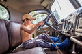 Little Boy Driving A Big Truck In The Summer Stock Photography - 85409172