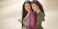 Travel Concept. Two Gordeous Women Sisters Traveling In Desert. Arabian Indian Movie Stars. Royalty Free Stock Photography - 85411537