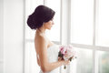 Stunning Young Bride Holding Bouquet Stock Photo - 85432530