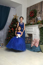 Two Sisters At The Christmas Tree Royalty Free Stock Photo - 85476875