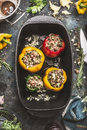 Colorful Bell Stuffed Paprika Peppers In Iron Cooking Pot On Dark Rustic Kitchen Table Background Royalty Free Stock Photos - 85486628