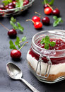 Cheesecake In A Glass Jar With Cherries Royalty Free Stock Image - 85494006