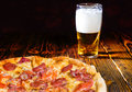 Tasty Pepperoni Pizza On Wooden Table Near A Glass Of Beer Royalty Free Stock Photo - 85513935
