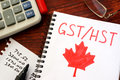 GST / HST Written In A Note. Royalty Free Stock Photo - 85546365