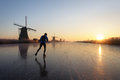 Ice Skating At Sunrise In The Netherlands Royalty Free Stock Image - 85575546