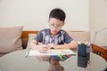 Boy At The Table Draw With Color Pencils Stock Photo - 85588160