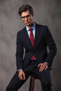 Serious Young Business Man Sitting On A Stool Royalty Free Stock Images - 85592999