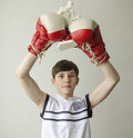 Boy With His Hands Raised In Boxing Gloves In A Victory Gesture With A Figurine Of A Boxer Stock Photography - 85615112