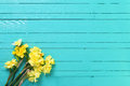 Yellow Narcissus Or Daffodil Flowers On Aquamarine  Wooden Backg Royalty Free Stock Photos - 85618018