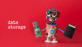 Data Storage Concept. Robot Toy With Usb Flash Stick And Memory Card On Red Background. Copy Space Macro View Royalty Free Stock Photo - 85619275