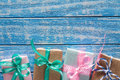 Gift Boxes In Paper On A Blue Wooden Table Royalty Free Stock Images - 85620569