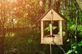 Wooden Handmade Bird Feeder In Form Of Little House Stock Photography - 85625782