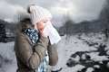 Woman In Winter Clothes Holding A Tissue To Her Nose Royalty Free Stock Photo - 85634315