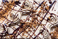 Chocolate Cream Cake Overhead View Close Up Background Stock Photos - 85640013