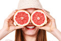 Girl Covering Eyes With Two Halfs Of Grapefruit Citrus Fruit Stock Image - 85641661