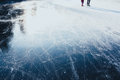 Ice Background. Ice Surface Texture With Skaters Stock Image - 85693591