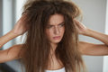 Woman With Holding Long Damaged Dry Hair. Hair Damage, Haircare. Royalty Free Stock Photo - 85707565
