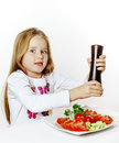 Cute Little Girl With Salad And Pepper Box Stock Photo - 85713250