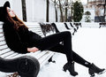 Young Pretty Modern Hipster Girl Waiting On Bench At Winter Snow Park Alone, Lifestyle People Concept Royalty Free Stock Photos - 85726138