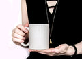 Girl In Black Dress Is Holding White Cup In Hands. Royalty Free Stock Images - 85786569