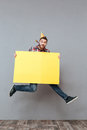 Happy Young Bearded Birthday Man Holding Copyspace Board Jumping Royalty Free Stock Images - 85842309