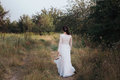 Yong Bride Spinning In A White Dress On The Bank On Nature. Royalty Free Stock Image - 85860776