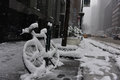 Bicycle Covered In Snow During Winter Storm Niko Manhattan, New York City Stock Photos - 85874273