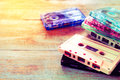 Retro Tape Cassette Over Wooden Table Royalty Free Stock Images - 85888199