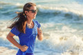 Girl Running On The Ocean Beach Royalty Free Stock Images - 85951999