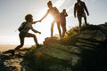 Young People On Mountain Hike At Sunset Stock Images - 86055884
