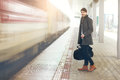 Standing On Railway Platform Royalty Free Stock Image - 86057116