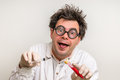 Crazy Scientist Performing Experiments In Laboratory Royalty Free Stock Photos - 86067528