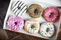 Fresh Baked Glazed Donuts In A Box Royalty Free Stock Photography - 86069677