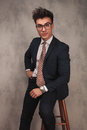 Young Elegant Business Man Sitting On A Stool Stock Photo - 86069950