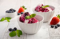 Ice Cream With Blueberries And Strawberries In White Bowl On White Wooden Background Royalty Free Stock Images - 86108809