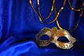 Gold Venetian Mask On Blue Silk Background Stock Photos - 86113153