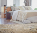 Wooden Table Top With Blur Of Modern Bedroom Interior With White Pillows On Bed Royalty Free Stock Photos - 86142118
