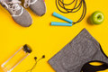Fitness Accessories On Yellow Background. Sneakers, Bottle Of Water, Headphones And Sport Top. Royalty Free Stock Photos - 86154958