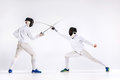 The Two Men Wearing Fencing Suit Practicing With Sword Against Gray Royalty Free Stock Photos - 86170658