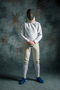The Man Wearing Fencing Suit With Sword Against Gray Stock Photography - 86171142