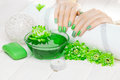 Beautiful Green Manicure With Chrysanthemum And Towel On The White Wooden Table. Spa Stock Photo - 86171390