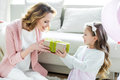 Girl Presenting Gift To Mother Royalty Free Stock Image - 86171526