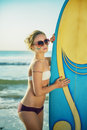 Surf Girl Looking Out At Blue Ocean Royalty Free Stock Image - 86179876