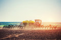 Tractor Plowing Farm Field In Preparation For Spring Planting Stock Photo - 86194250